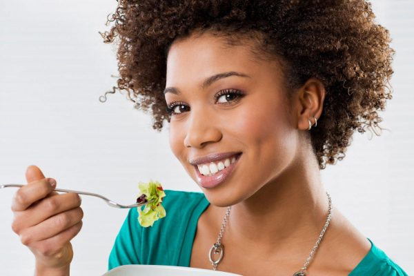 Iron and Vitamin C - Woman Eating a Salad